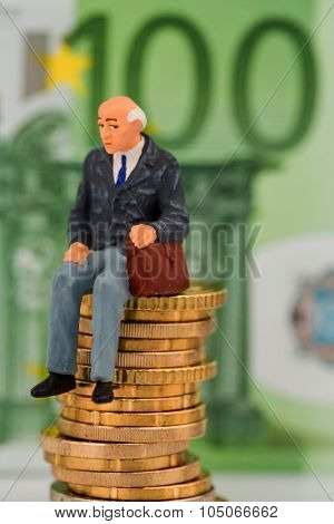 pensioners sitting on money stack, symbol photo for pension, retirement, pension