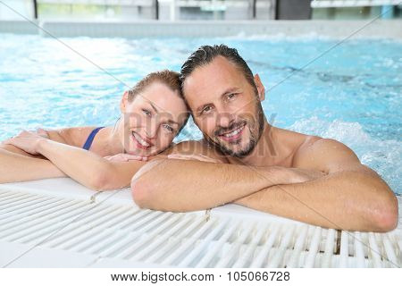 Portrait of couple relaxing in spa center