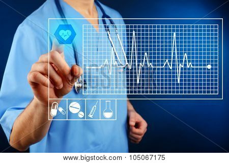 Cardiologist working with modern computer interface
