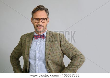 Stylish guy with eyeglasses and bow tie, isolated