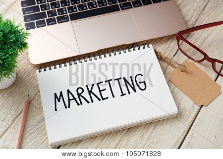 Marketing Concept With Laptop On Wood Desk