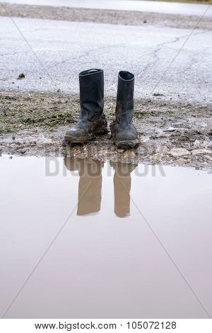 Reflection In A Pool Of Muddy Boots
