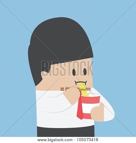 Businessman Eating Instant Noodle Cups