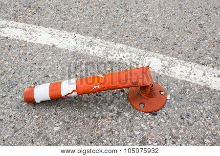 Orange Broke Bollard Inside Car Park