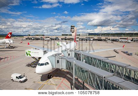 ZURICH - September 21:  Planes preparing for take off at Zurich Airport on September 21, 2014 in Zurich, Switzerland. Zurich airport is home port for Swiss Air and one of the biggest european hubs.