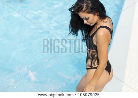 Pretty Young Woman By The Pool
