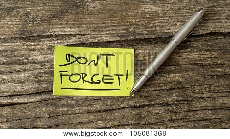 Overhead View Of A Don't Forget Reminder Message