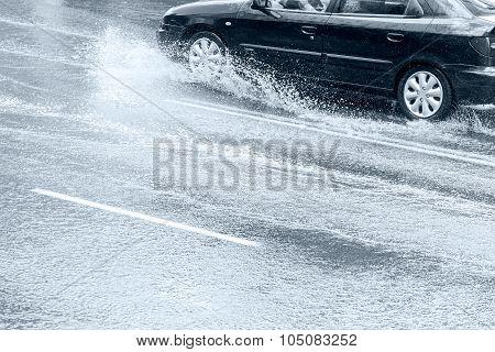 Car Riding On Wet Street