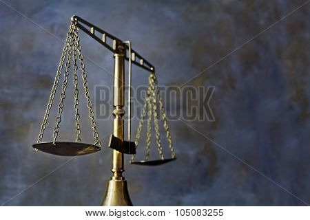 Vintage Brass Scales Of Justice Against A Dark Rustic Background
