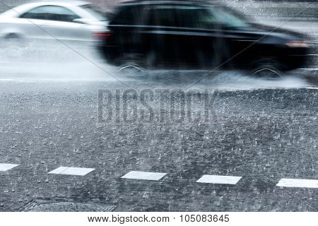 Blurred Cars In Torrential Rain