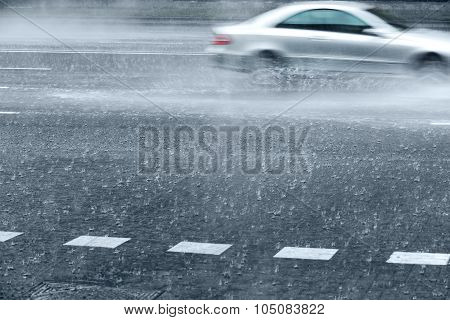 Wet Road With Fast Cars