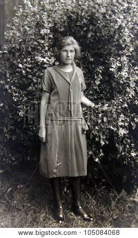 Old Photo Of The Girl In The Garden