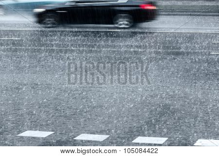 Blurred Cars On Rainy Street