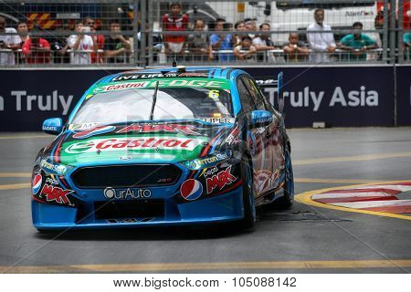 KUALA LUMPUR, MALAYSIA - AUGUST 08, 2015: Chaz Mostert from the Pepsi Max Crew team races in the V8 Supercars Street Challenge at the 2015 Kuala Lumpur City Grand Prix.