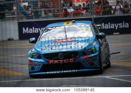 KUALA LUMPUR, MALAYSIA - AUGUST 08, 2015: Scott McLaughlin from the Volvo Polestar Racing team races in the V8 Supercars Street Challenge at the 2015 Kuala Lumpur City Grand Prix.