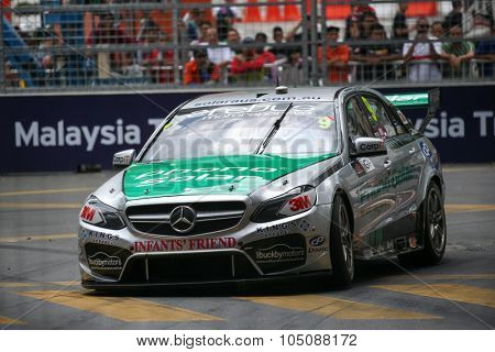 KUALA LUMPUR, MALAYSIA - AUGUST 08, 2015: Will Davidson from the Erebus Motorsports team driving a Mercedes car races in the V8 Supercars Street Challenge at the 2015 Kuala Lumpur City Grand Prix.