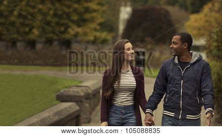 In Love Interracial couple cuddling in a park