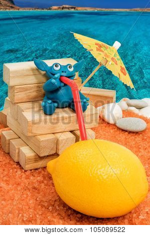 Plasticine monster drinking lemon on the beach