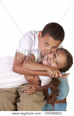 Cute Brother And Sister On An Isolated Background