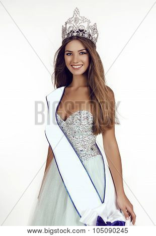 Beautiful Girl With Long Hair Wears Luxurious Dress And Crown