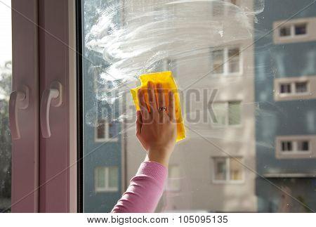 Female Hand Washing A Window