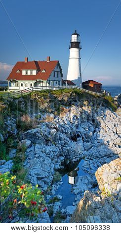 Vertical panorama of the Portland Head Light, Portland, Maine, United States. The lighthouse is reflected in the rockpools below.