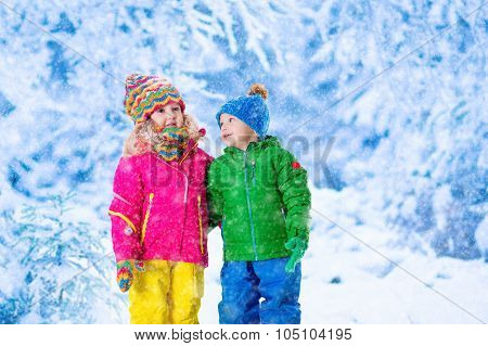 Kids Playing In Snowy Winter Park