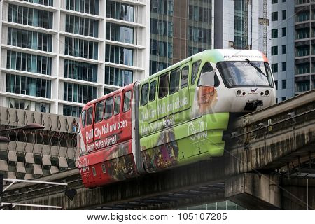 KUALA LUMPUR, MALAYSIA - AUGUST 8, 2015: The Monorail train system is a public commuter service that runs on elevated tracks above the roads and passes between buildings in the city of Kuala Lumpur.