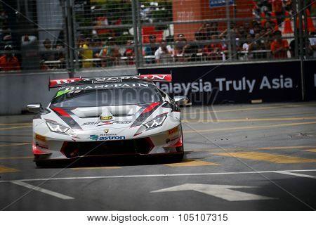 KUALA LUMPUR, MALAYSIA - AUGUST 08, 2015: Sam Lok from Hong Kong drives a Lamborghini Huracan Super Trofeo LP620 car takes turn 2 in the KL City GT CUP Race of the 2015 Kuala Lumpur City Grand Prix.