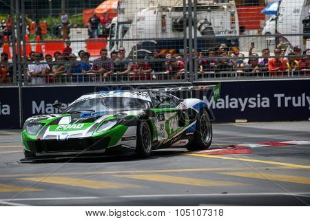 KUALA LUMPUR, MALAYSIA - AUGUST 08, 2015: Frank Yu drives a Ford GT3 car races in the KL City GT CUP Race of the 2015 Kuala Lumpur City Grand Prix.