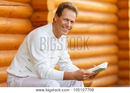 Nice man reading book