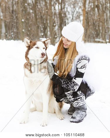 Happy Young Woman In The Winter Park With Dog