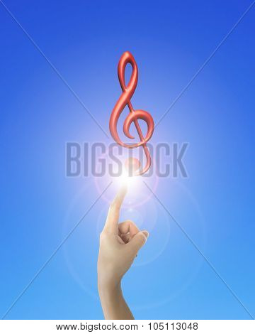 Human Hand Forefinger Pointing Music Note With Bright Light