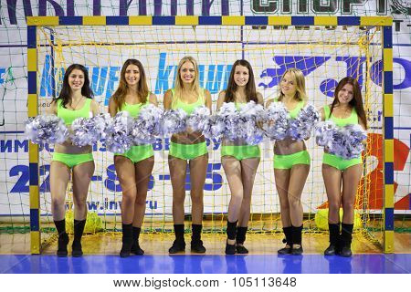 MYTISHCHI, RUSSIA - OCT 16, 2014: Portrait of six beautiful cheerleaders (with model release) with silvery pompons near football goal on the Russian Futsal Super League in Mytishchi