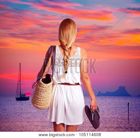 Blond braid tourist girl looking sunset holding flip flop in beach of Formentera photomount