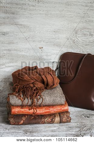 Women's Clothing And Accessories - Skirt, Turtleneck, Scarf, Bag, Bright Wooden Surface