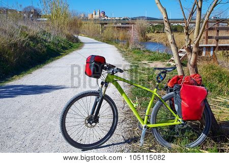 cycling tourism MTB bike in Ribarroja Parc de Turia with paniers and saddlebag
