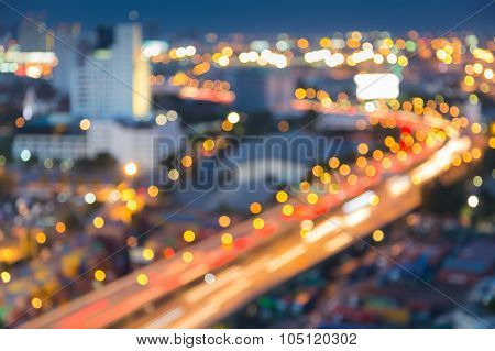 Abstract blurred bokeh light of city downtown highway curved at nigth