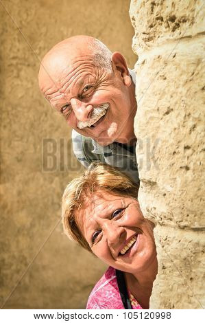 Happy Senior Couple In Love During Retirement - Joyful Elderly Lifestyle With Man And Woman With Fun