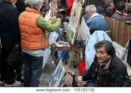 Paris - Circa 1 May 2013: Public Painter And Buyer On Montmartre