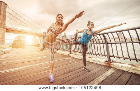 Two Girls Making Stretching In Brooklyn Pier At Morning Time.