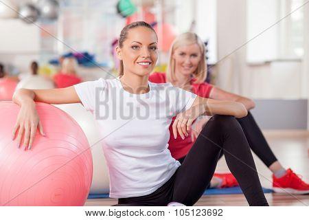 Cute slim girls are exercising in fitness center