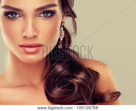 Beautiful brunette girl with hair curled tail