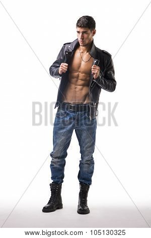 Handsome young man wearing leather jacket on naked torso, isolated over white