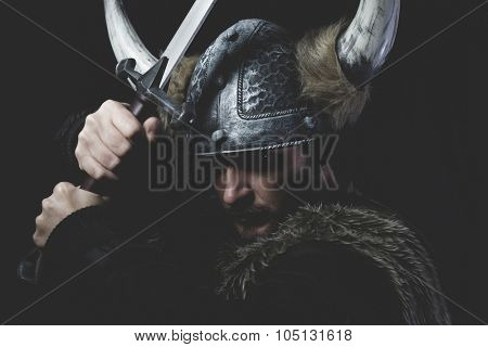 Terrified, Viking warrior with iron sword and helmet with horns