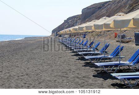 Empty Sunbeds On The Beach, Santorini, Greece