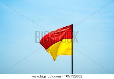 Red And Yellow Swimming Safety Flag Flapping