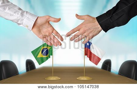 Brazil and Chile diplomats agreeing on a deal