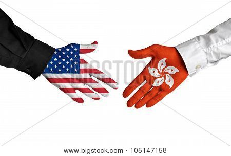 United States and Hong Kong leaders shaking hands on a deal agreement