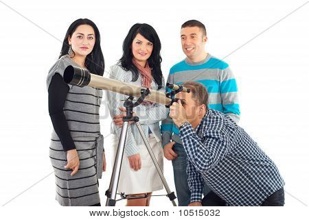 Four Friends Having Fun With Telescope